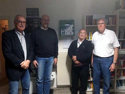 Dr. Ulrich Schmelzer (Leiter Herzsportgruppe) mit M. Kieckbusch (GV), R. Krüger (TSV) und J. Schreiber (GV Schlutup). Foto: GV